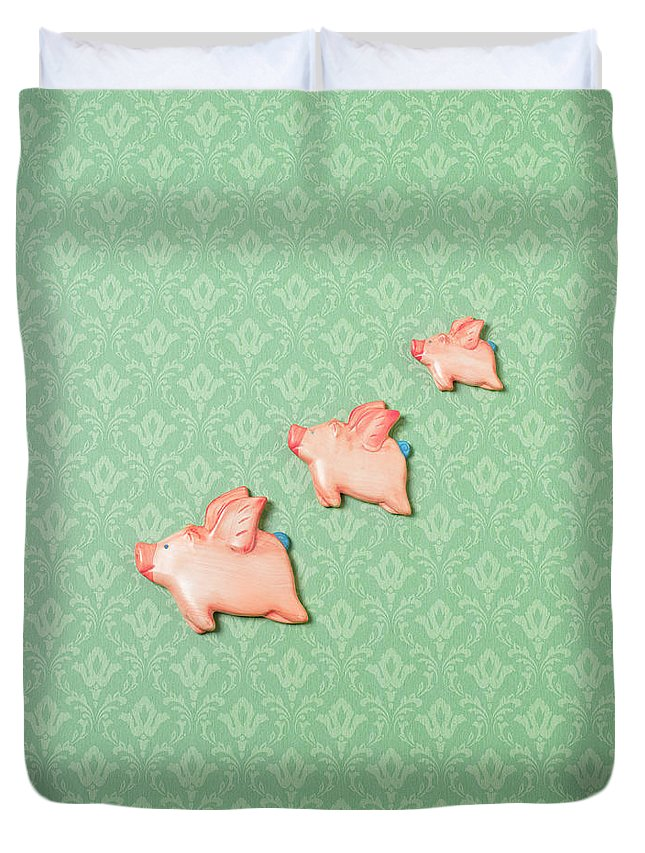 Disbelief Duvet Cover featuring the photograph Flying Pig Ornaments On Wallpapered by Peter Dazeley