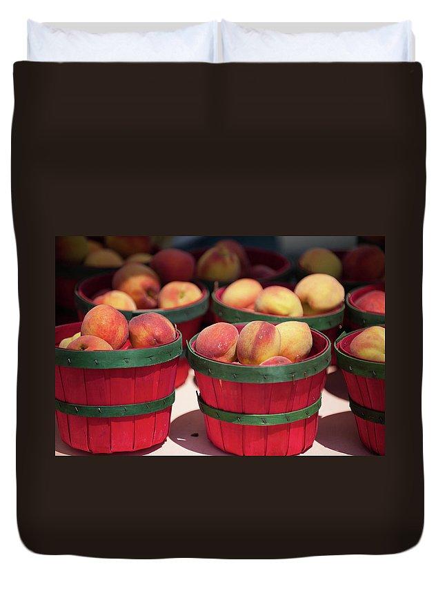 Retail Duvet Cover featuring the photograph Fresh Texas Peaches In Colorful Baskets by Txphotoblog - Randy Ennis