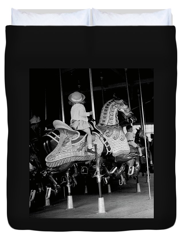 Child Duvet Cover featuring the photograph Girl Riding A Carousel by George Marks