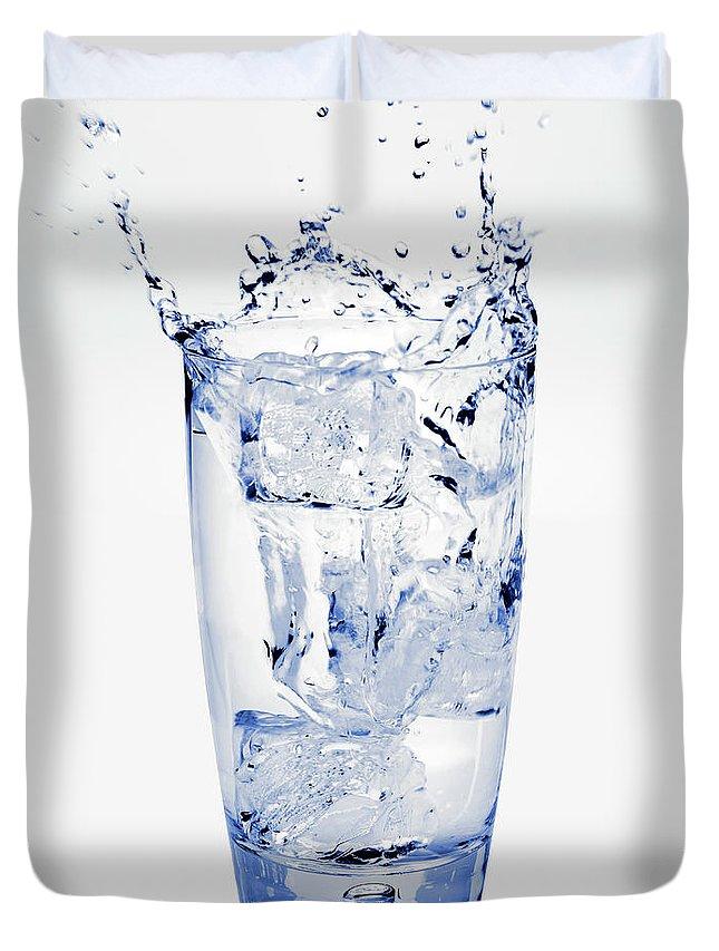 White Background Duvet Cover featuring the photograph Glass Of Water Splashing Around by Maria Toutoudaki