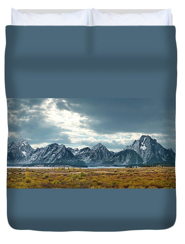 Scenics Duvet Cover featuring the photograph Grand Tetons In Dramatic Light by Ed Freeman
