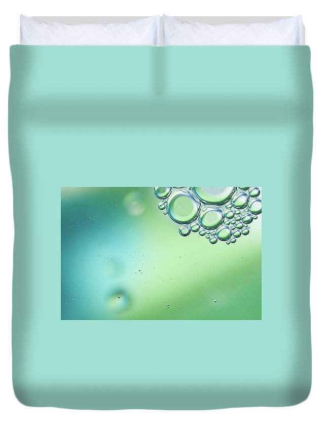 Art Duvet Cover featuring the photograph Green And Blue Bubbles Background by Martin Wahlborg