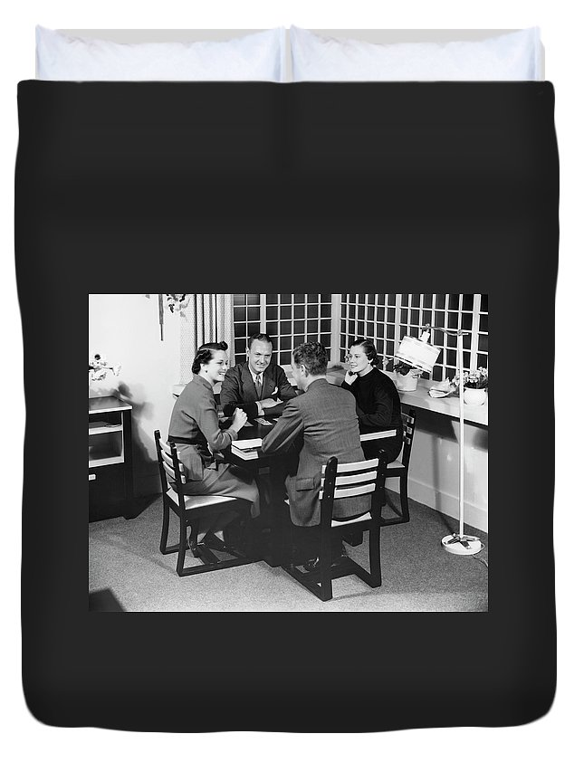 Heterosexual Couple Duvet Cover featuring the photograph Group At A Table by George Marks