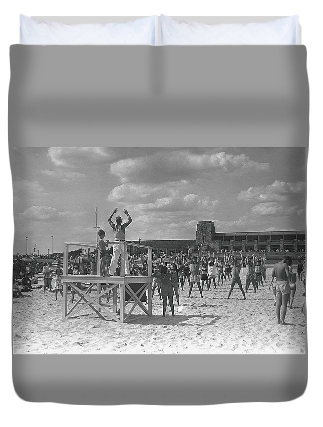 Human Arm Duvet Cover featuring the photograph Group Of People Exercising On Beach, B&w by George Marks