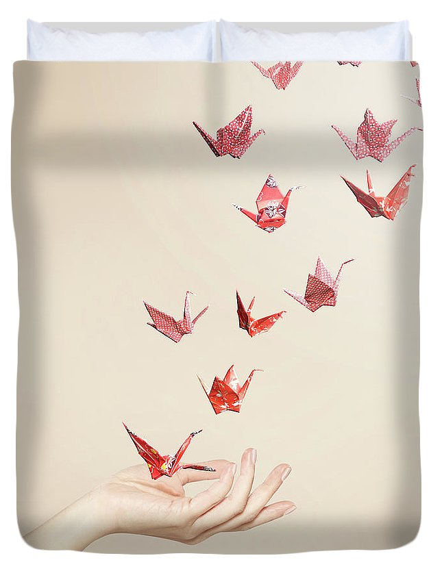 People Duvet Cover featuring the photograph Group Of Red Origami Cranes Flying Away by Paper Boat Creative