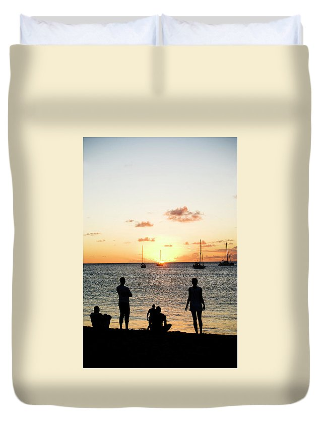 Recreational Pursuit Duvet Cover featuring the photograph Group Of Young Friends On Beach At by Jaminwell