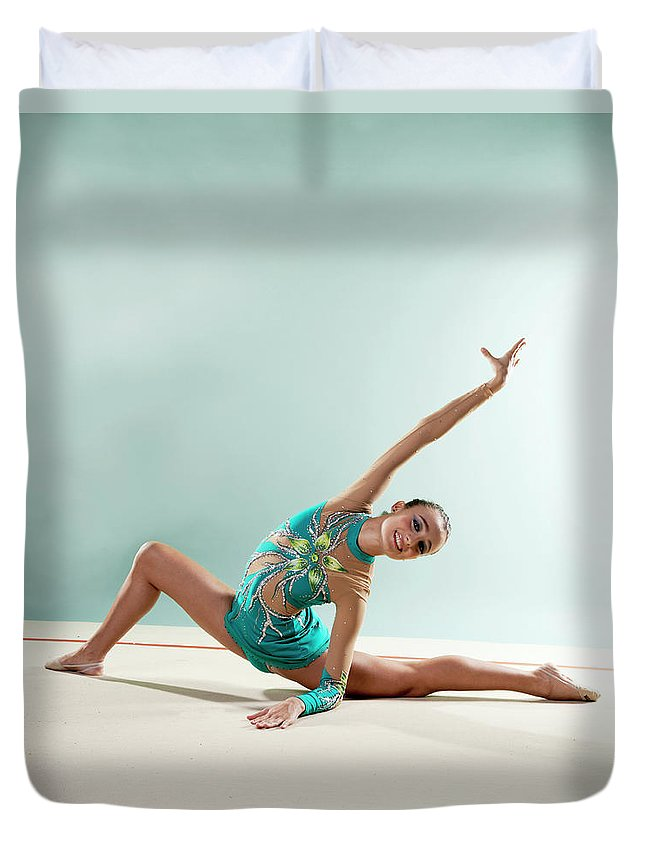 Human Arm Duvet Cover featuring the photograph Gymnast, Smiling, Bending Backwards by Emma Innocenti