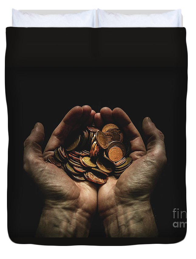 Coin Duvet Cover featuring the photograph Hands Holding Coins Against Black by Andy Kirby