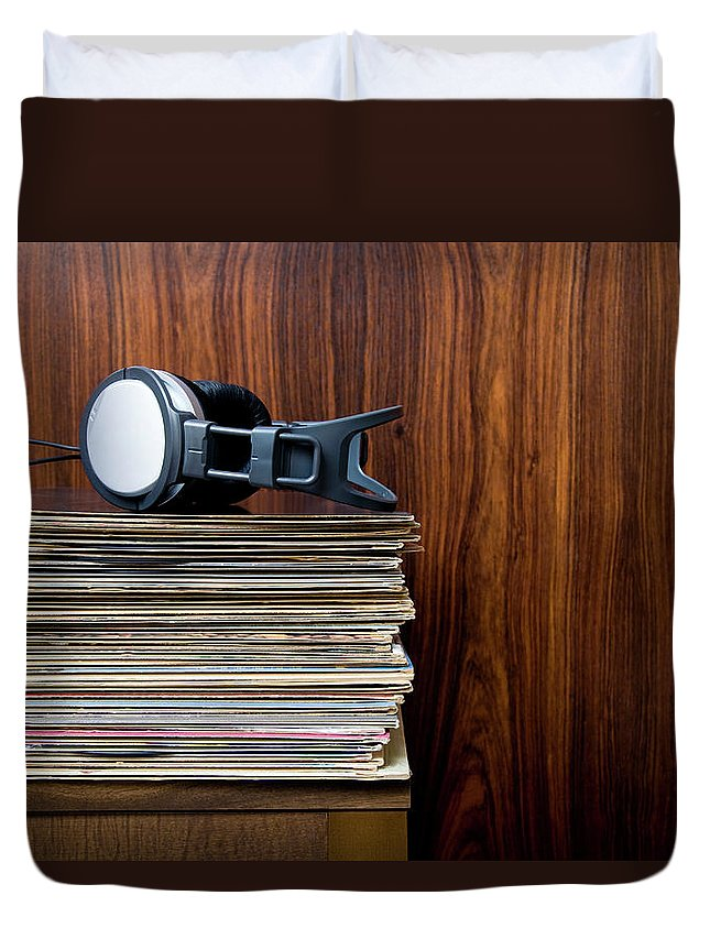 Technology Duvet Cover featuring the photograph Headphones Laying On Stack Of Vinyl by Steven Errico