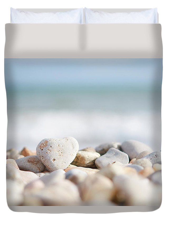 Large Group Of Objects Duvet Cover featuring the photograph Heart Shaped Pebble On The Beach by Alexandre Fp