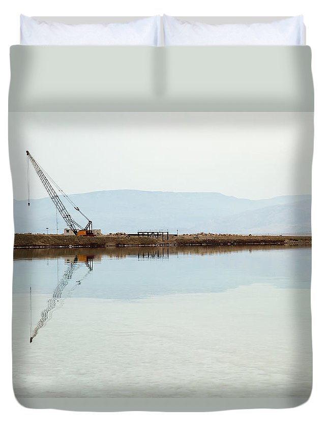 Working Duvet Cover featuring the photograph Heavy Machinery At The Dead Sea by Eldadcarin