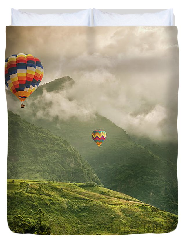 Tranquility Duvet Cover featuring the photograph Hot Air Balloons Over Tea Plantations by Nicolo Sertorio