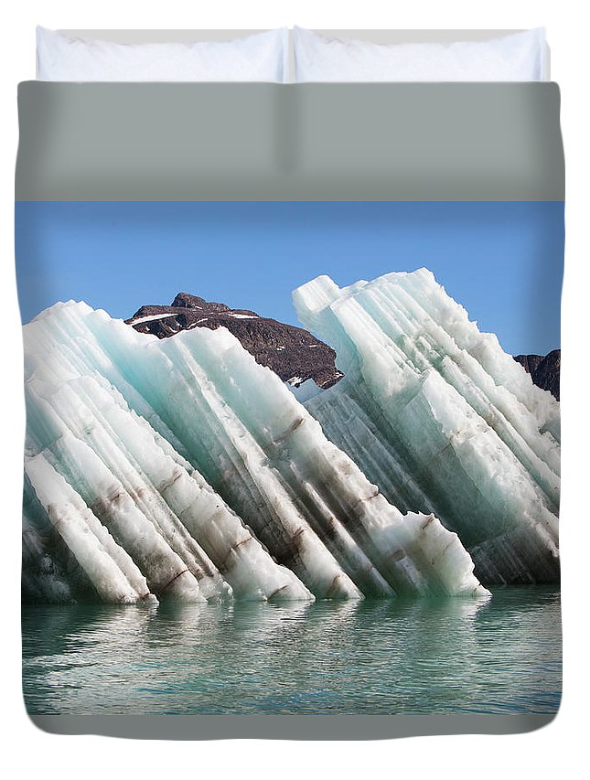 Iceberg Duvet Cover featuring the photograph Iceberg Streaked With Rock Debris by Anna Henly