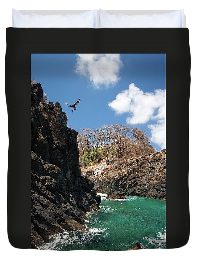 Tranquility Duvet Cover featuring the photograph Jumping by Mauricio M Favero