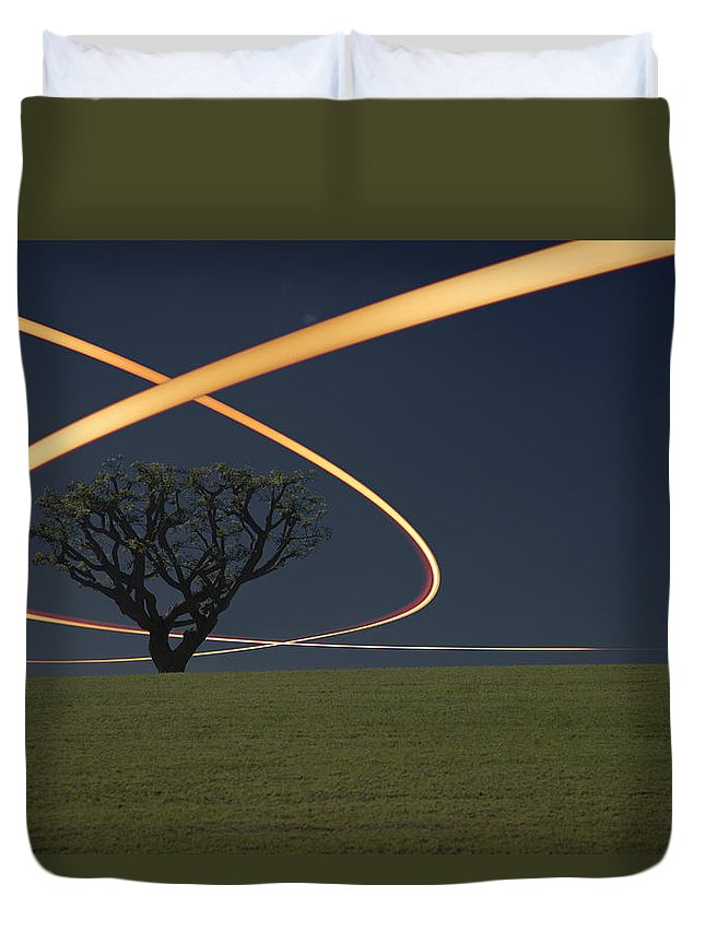 Scenics Duvet Cover featuring the photograph Light Trails Around Tree by Paul Taylor