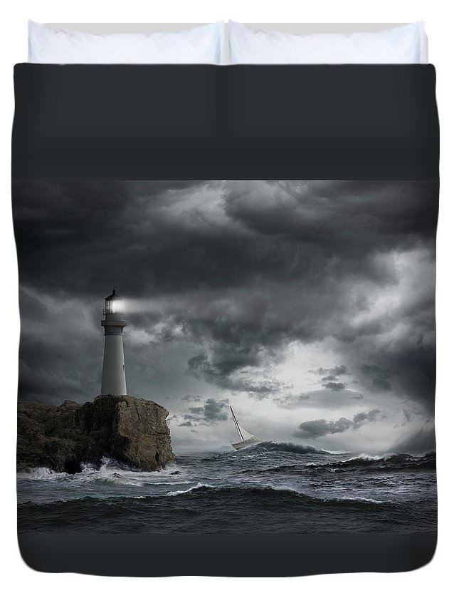 Risk Duvet Cover featuring the photograph Lighthouse Shining Over Stormy Ocean by John M Lund Photography Inc