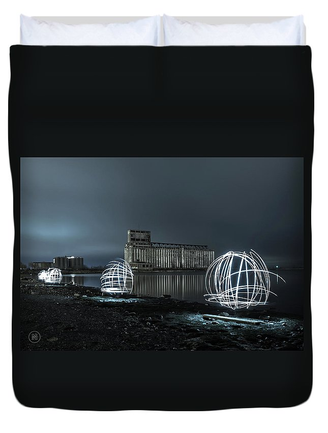 Galagher Pier Duvet Cover featuring the photograph Lights in the Night by Dave Niedbala