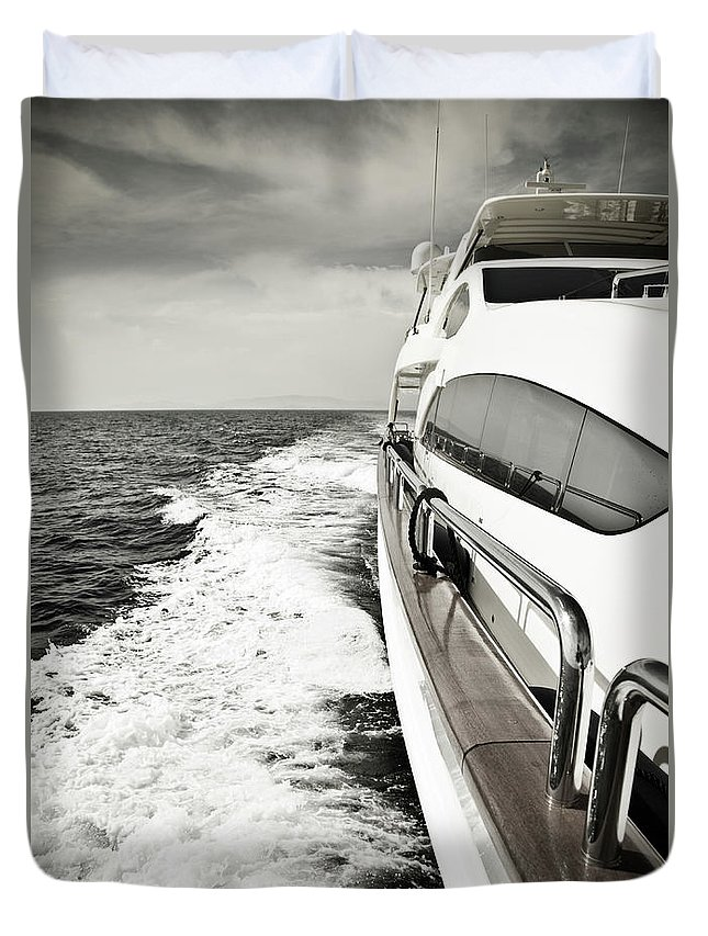 Desaturated Duvet Cover featuring the photograph Luxury Yacht Sailing At High Speed In by Petreplesea