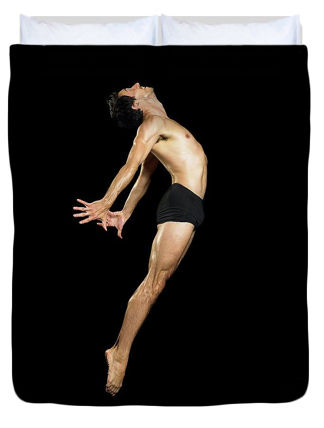 Human Arm Duvet Cover featuring the photograph Male Dancer Jumping by Image Source