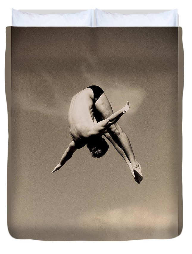Diving Into Water Duvet Cover featuring the photograph Male Diver In Mid-air by David Madison