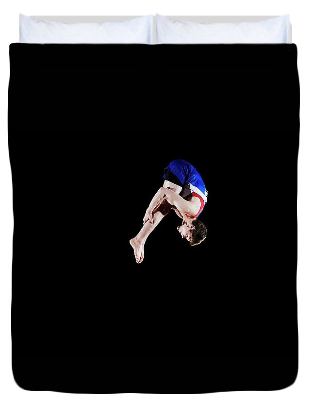 Focus Duvet Cover featuring the photograph Male Gymnast 16-17 Mid Air, Black by Thomas Barwick
