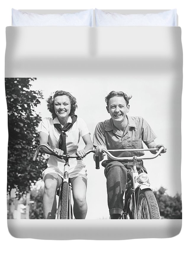 Young Men Duvet Cover featuring the photograph Man And Woman Riding Bikes, B&w, Low by George Marks