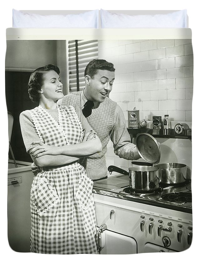 Heterosexual Couple Duvet Cover featuring the photograph Man Looking Into Pot In Domestic by George Marks