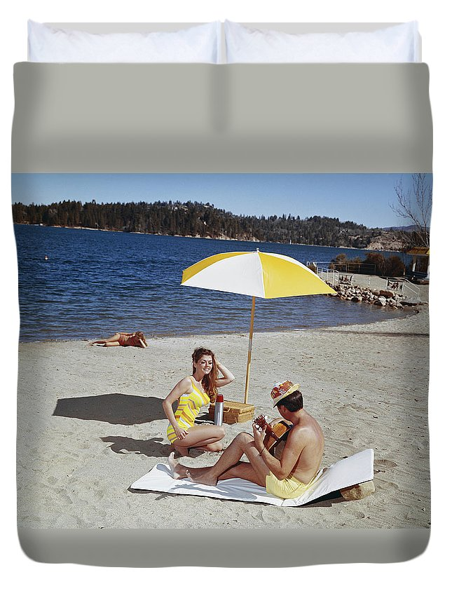 People Duvet Cover featuring the photograph Man Playing Guitar While Woman Dancing by Tom Kelley Archive