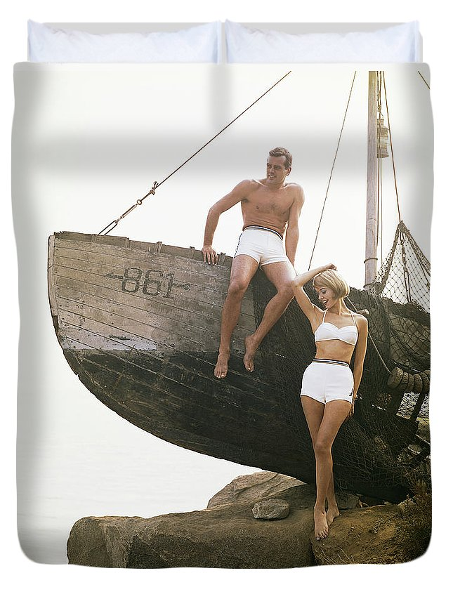 Hand Raised Duvet Cover featuring the photograph Man Sitting Boat, Woman Standing Beside by Tom Kelley Archive