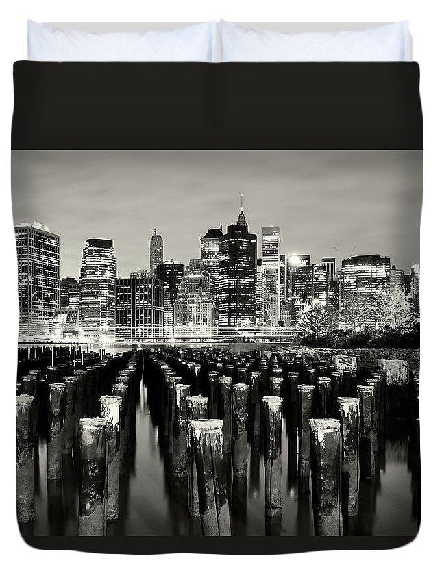 Wooden Post Duvet Cover featuring the photograph Manhattan At Night by Shobeir Ansari