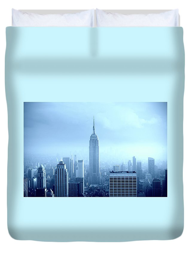 Lower Manhattan Duvet Cover featuring the photograph Manhattan Skyline In The Fog, Nyc. Blue by Lisa-blue