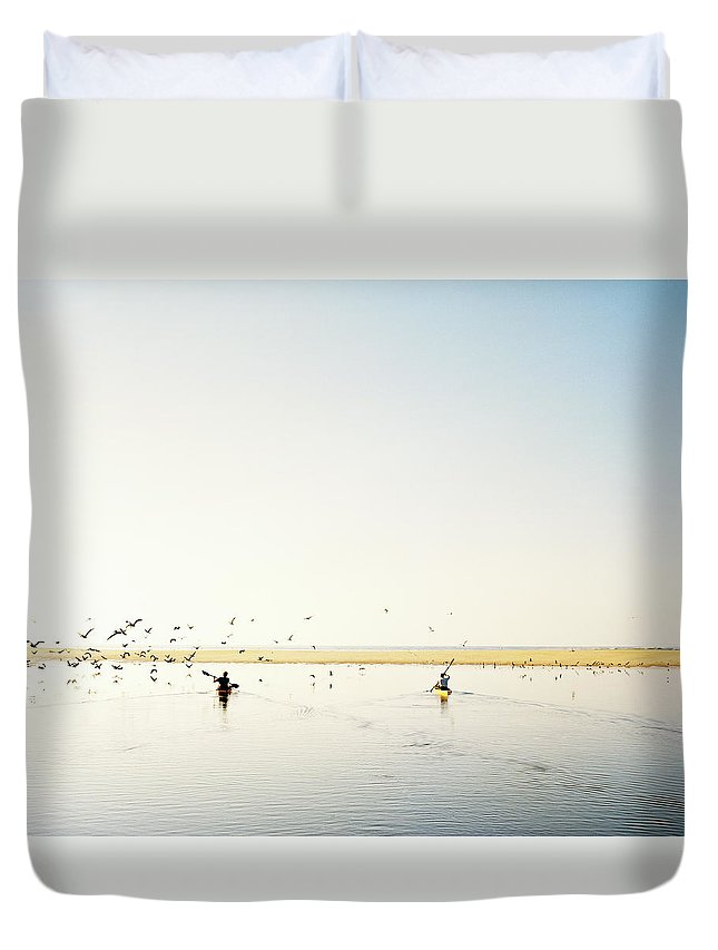 People Duvet Cover featuring the photograph Men Paddling Kayaks To The Beach by Julien Capmeil