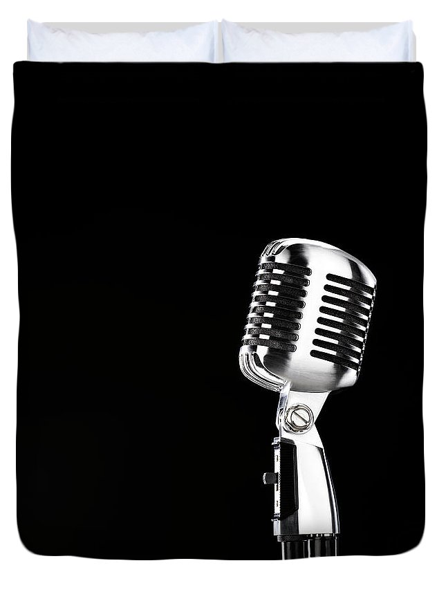 Music Duvet Cover featuring the photograph Microphone Against Black Background by Peter Dazeley