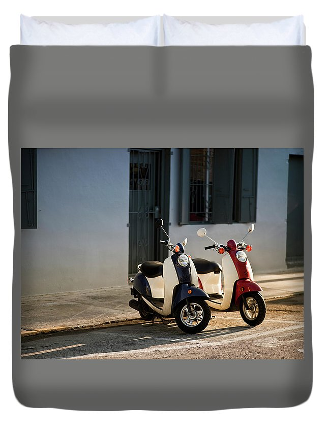 In A Row Duvet Cover featuring the photograph Motorbikes Parked On The Road by Pgiam