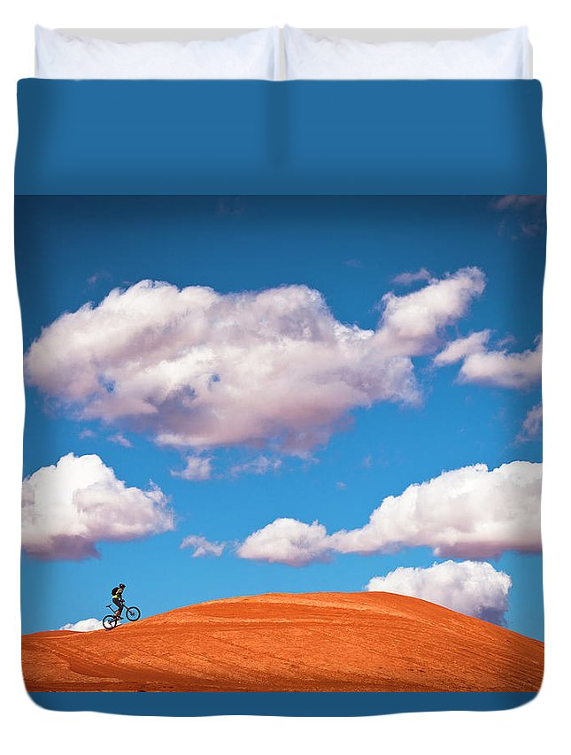 Slickrock Trail Duvet Cover featuring the photograph Mountain Biker Climbing On Slick Rock by Visualcommunications