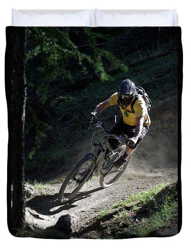 Sports Helmet Duvet Cover featuring the photograph Mountain Biker On Dirt Path by Michael Truelove