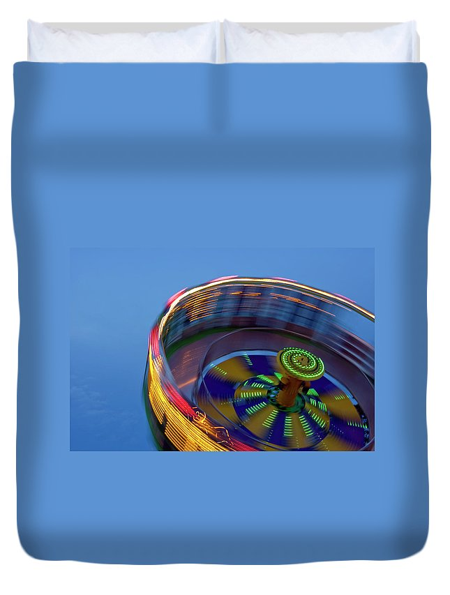 Carousel Duvet Cover featuring the photograph Multicolored Spinning Carnival Ride by By Ken Ilio