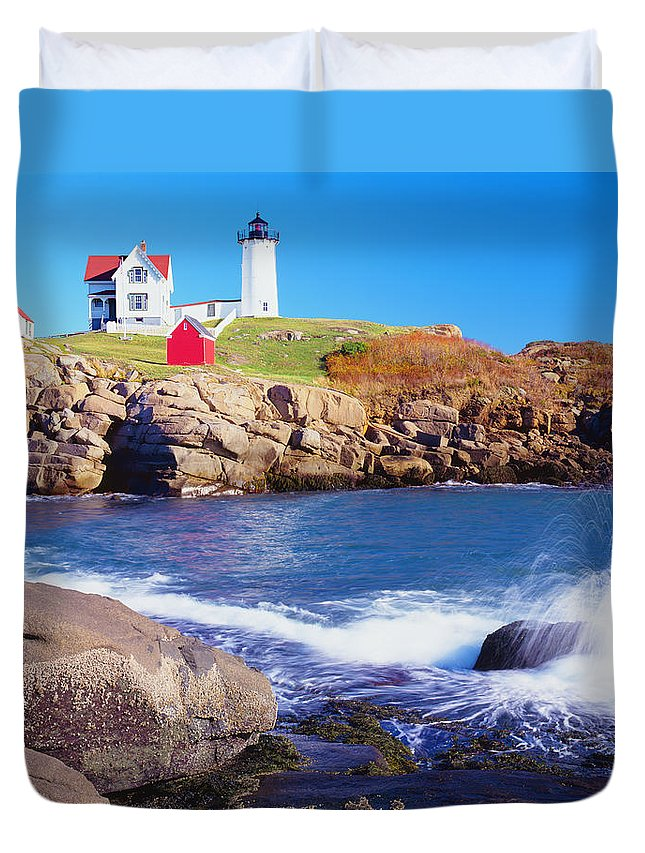 Water's Edge Duvet Cover featuring the photograph Nubble Lighthouse And Coastine Of Maine by Ron thomas