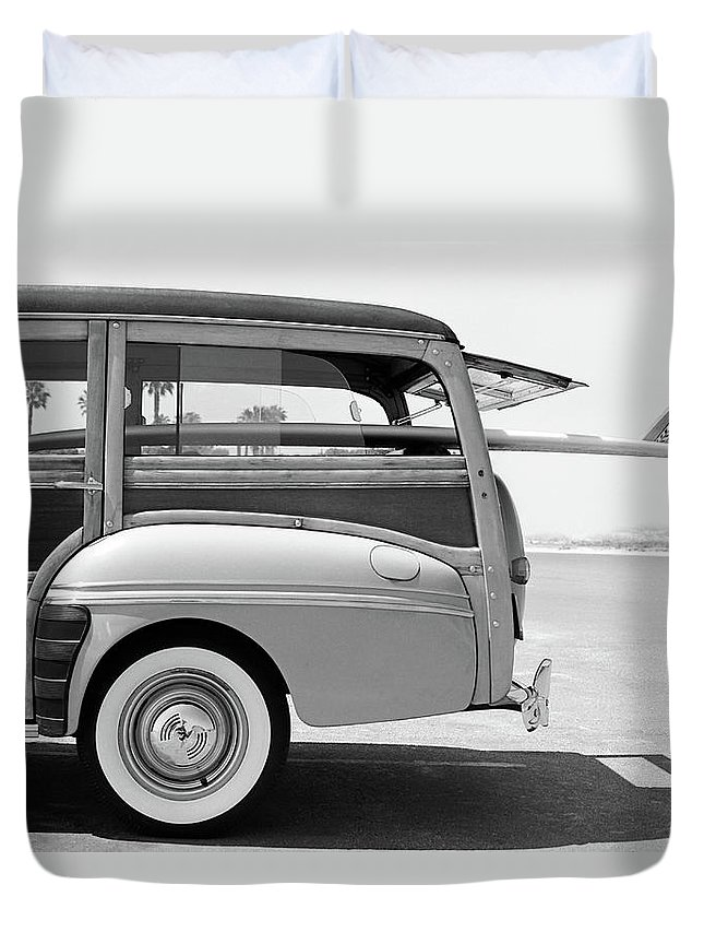 1950-1959 Duvet Cover featuring the photograph Old Woodie Station Wagon With Surfboard by Skodonnell