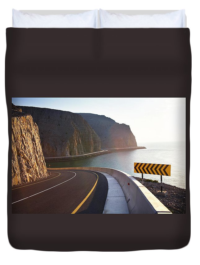 Curve Duvet Cover featuring the photograph Oman, Khasab, Road Round Mountain By by Christian Adams