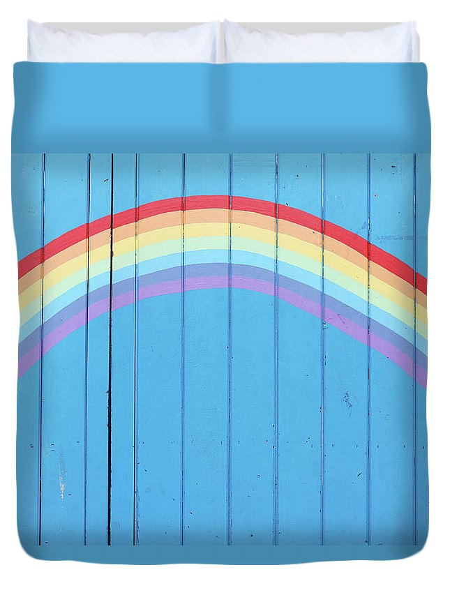 Art Duvet Cover featuring the photograph Painted Rainbow On Wooden Fence by Richard Newstead