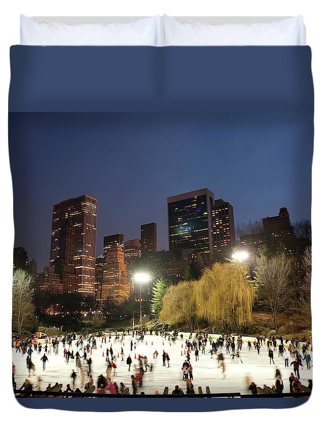 People Duvet Cover featuring the photograph Panorama Of People Ice Skating In by Studiokiet