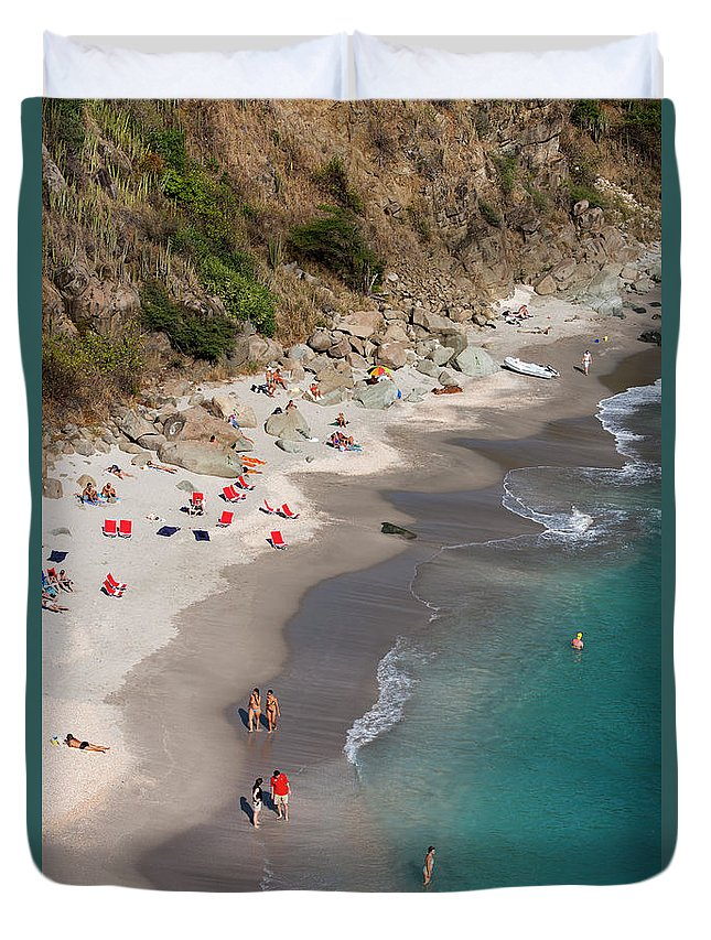 Water's Edge Duvet Cover featuring the photograph People Relax On Shell Beach by Holger Leue