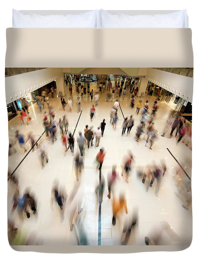 Crowd Duvet Cover featuring the photograph People Walking In Shopping by Benimage
