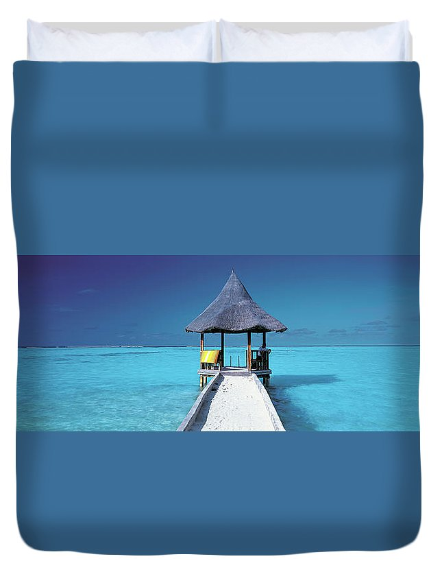 Tranquility Duvet Cover featuring the photograph Pier And Blue Indian Ocean, Maldives by Peter Adams