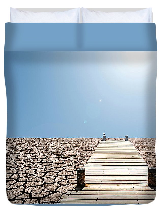 Environmental Damage Duvet Cover featuring the photograph Pier Over A Dry Lake Bed by John Lund