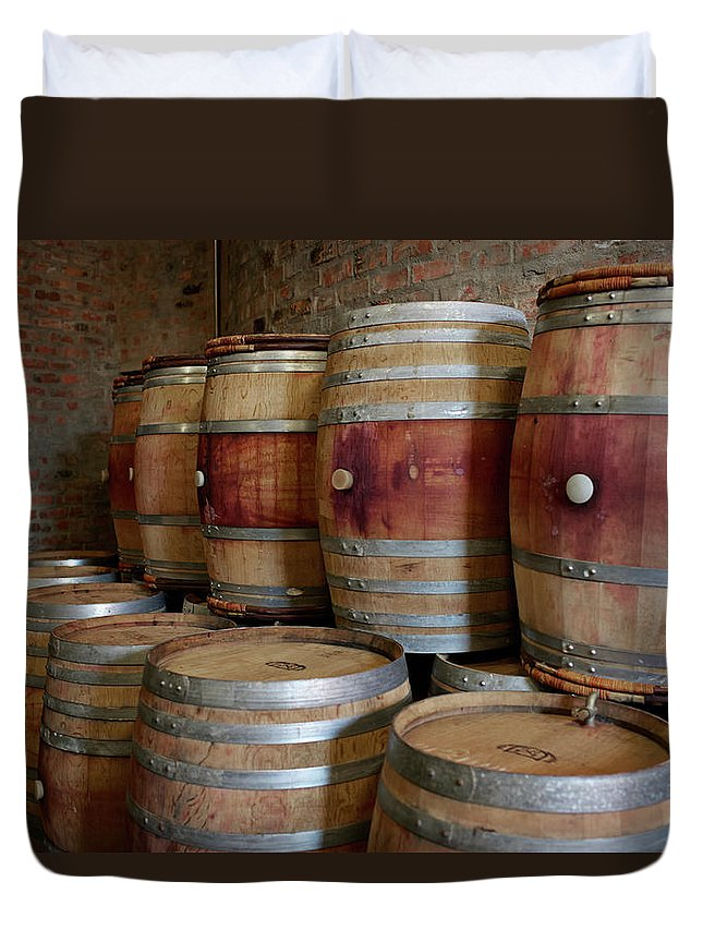 Stellenbosch Duvet Cover featuring the photograph Pile Of Wooden Barrels At Winery by Klaus Vedfelt