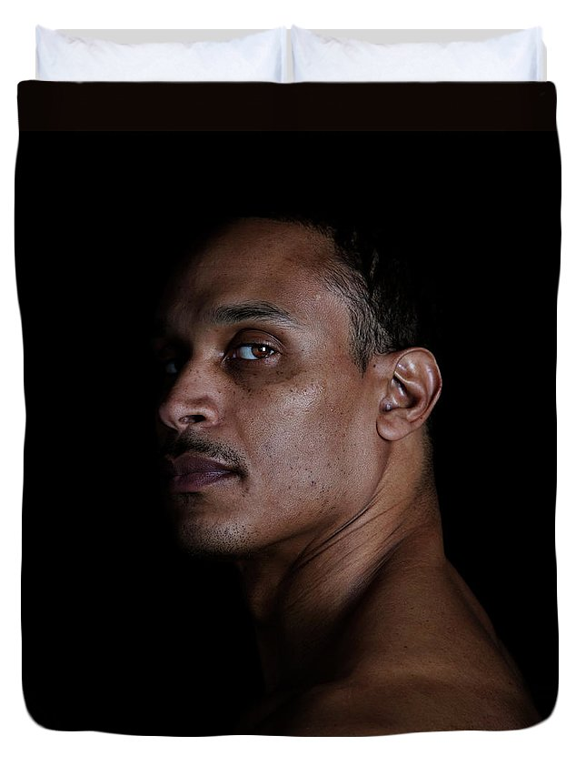People Duvet Cover featuring the photograph Portrait Of A Man On A Black Background by Michael Duva
