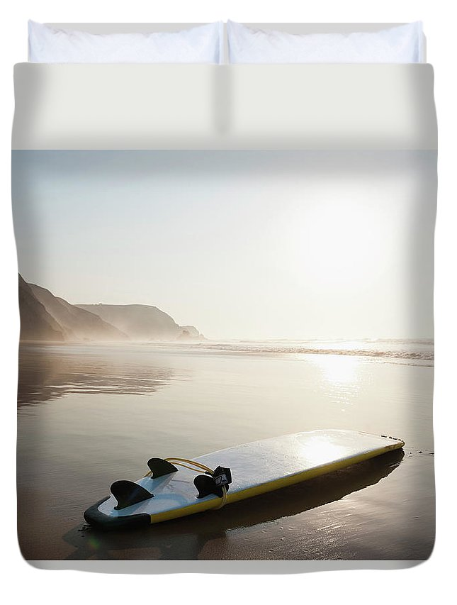 Algarve Duvet Cover featuring the photograph Portugal, Surfboard On Beach by Westend61
