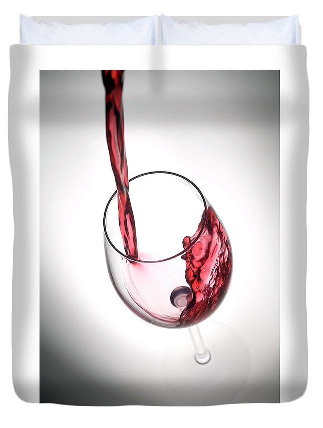Alcohol Duvet Cover featuring the photograph Pouring Red Wine Into A Glass by Stockcam